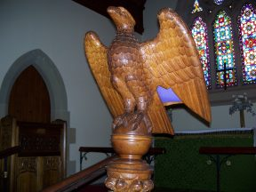 A wooden sculpture of an eagle in St Johns Church of England, Ross. Image by G Keri
