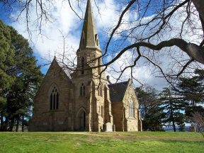 Uniting Church, Ross Tasmania, viewed through the trees. Image by G Keri
