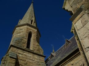 Uniting Church, Ross Tasmania, looking up at the roof and spires against the blue sky