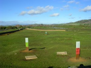 Green field with 2 interpretation panels at the Ross Female Factory