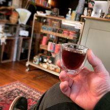 holding a glass with tea from Dinki