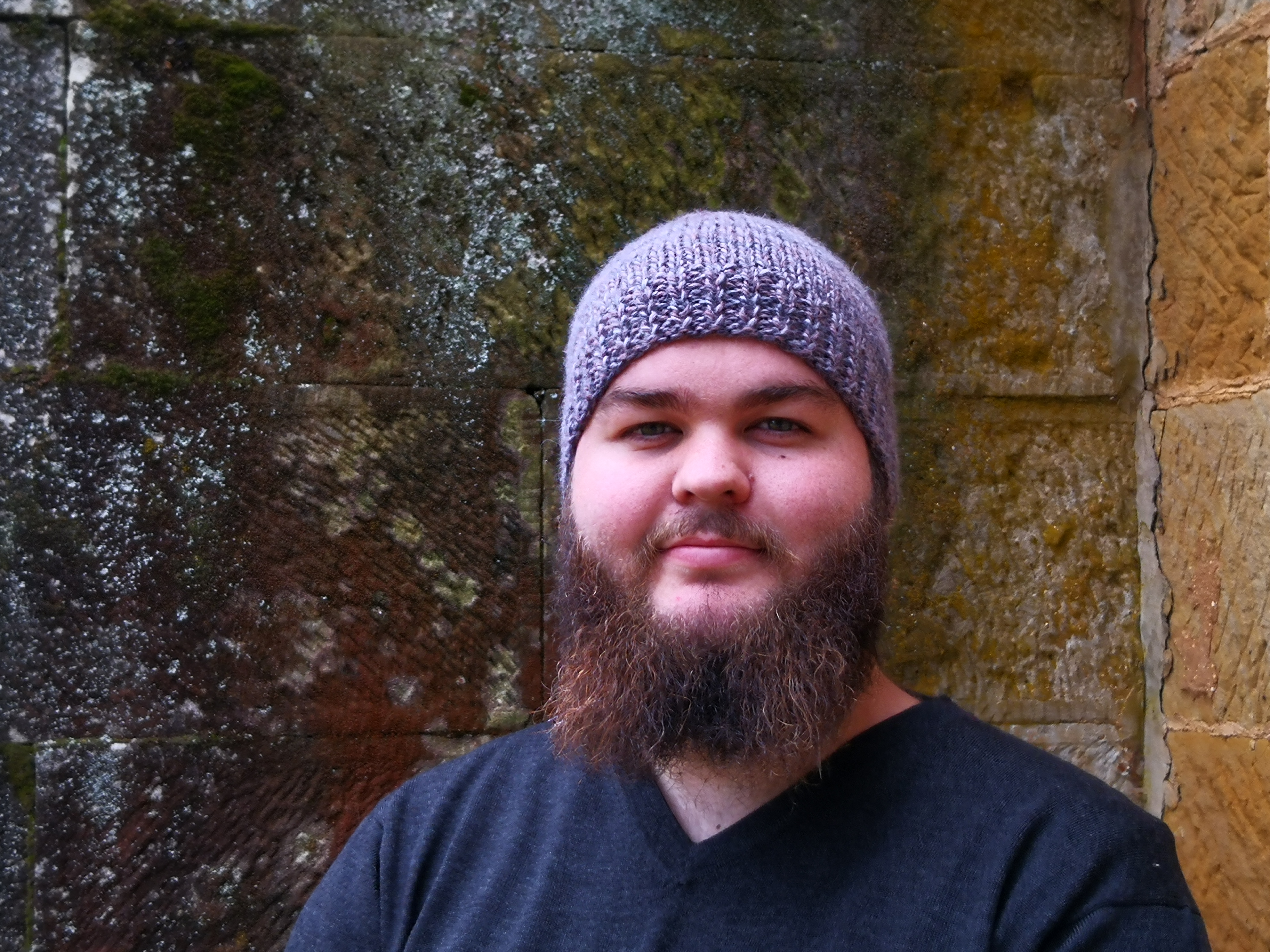 man in woolen beanie and jumper at the Tasmanian Wool Centre,